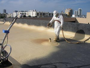contractor applying commercial foam roofing